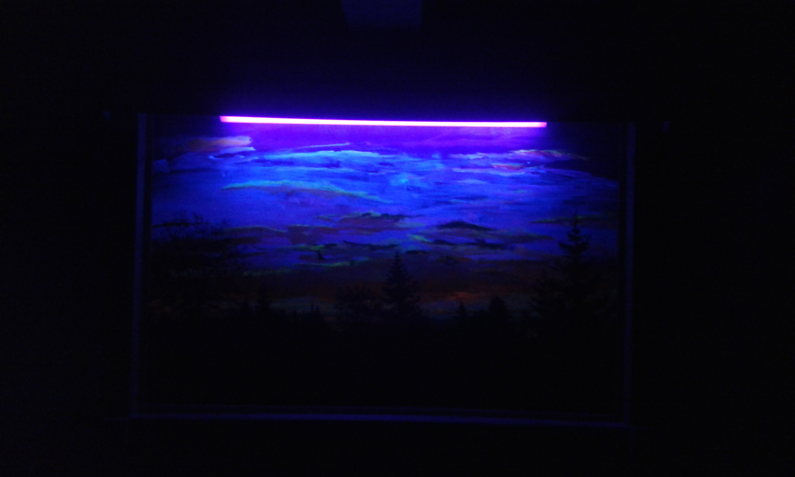 Jim's painting under a blacklight.
